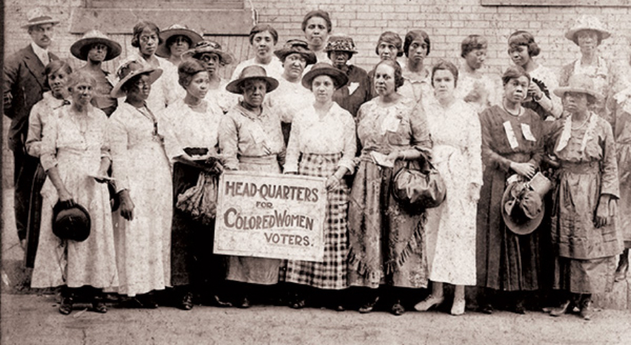 Women stand in protest for the right to vote.